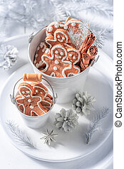Delicious gingerbread man for Christmas in white bucket
