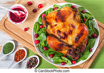 whole grilled chicken served with arugula, spinach and cranberry
