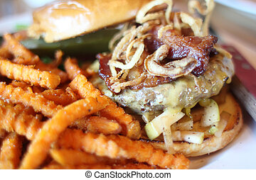 Delicious gourmet cheeseburger with bacon and apple and a...
