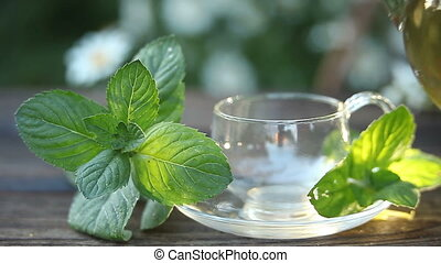 delicious green tea in a beautiful glass bowl on table