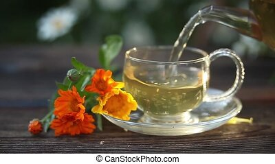delicious green tea in beautiful glass bowl on a table