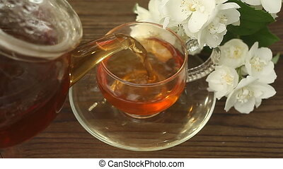 delicious green tea in beautiful glass bowl on tabledelicious green tea in beautiful glass bowl on table