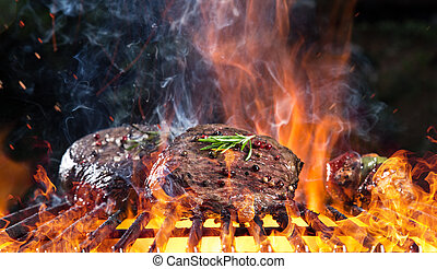 Delicious grilled beef steak on a barbecue grill.