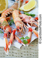 Delicious Grilled Langoustines with Lemon and Parsley on Newspaper closeup on Wicker background. Focus on Animal Eyes