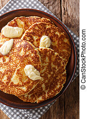 Delicious grilled pancakes with butter close-up on a plate. ...