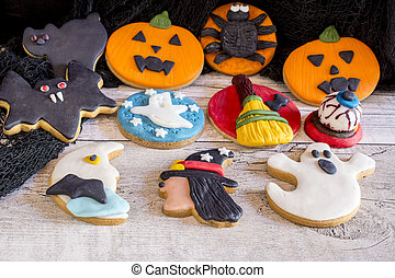 Delicious halloween cookies on wooden background
