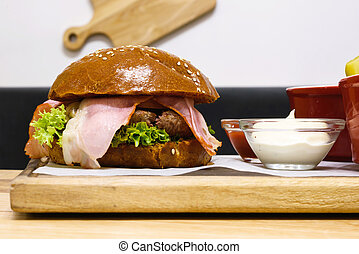 Delicious hamburger, medium rare, with bacon