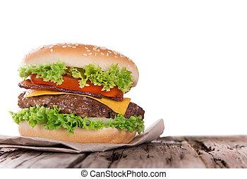 delicious hamburger on wood - Delicious hamburger on wooden...