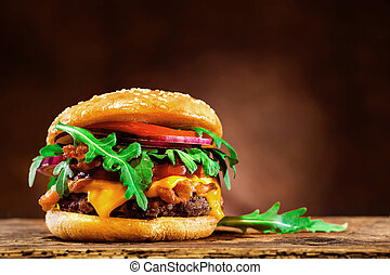Delicious hamburger on wooden table