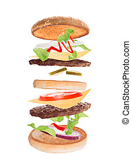 Delicious hamburger with flying ingredients