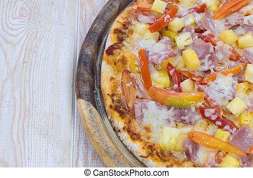 Delicious hawaiian pizza on wood