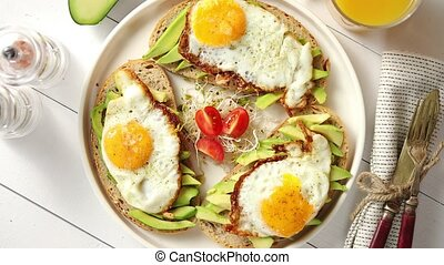 Delicious healthy breakfast with sliced avocado sandwiches...