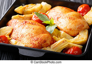 Delicious healthy food: chicken breast with artichokes and tomatoes close-up. horizontal