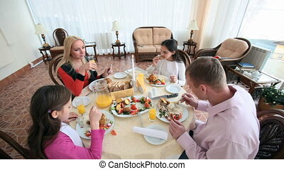 Delicious holiday - Family of four celebrating having a...