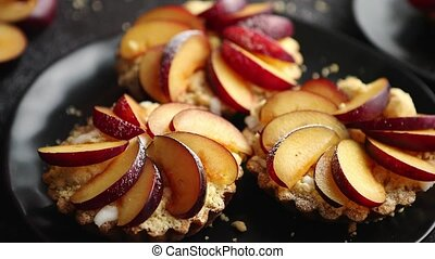 Delicious homemade mini tarts with fresh sliced plum fruit....