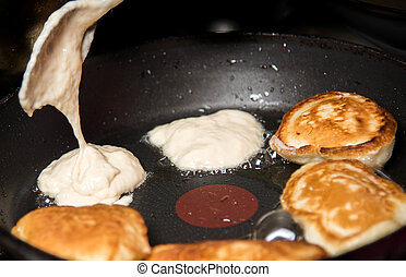 delicious homemade pancakes baking in the pan - delicious...