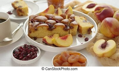 Delicious homemade peach or nectarine cake, fresh fruits, ...