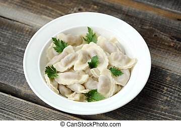 Delicious homemade ravioli with parsley in a plate