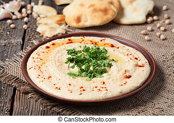 Delicious hummus creamy eastern traditional food in bowl ...