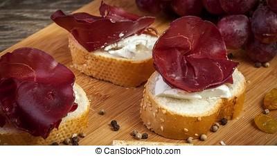 Delicious italian ham on wooden background. Restaurant...