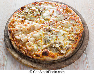 Delicious italian mix pizza on wood