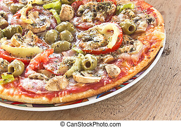 Delicious italian pizza on wooden background