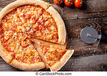 Delicious italian pizza on wooden table background