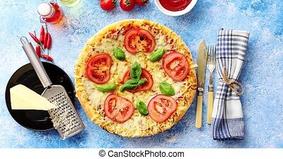 Delicious italian pizza served on blue stone table, shot...