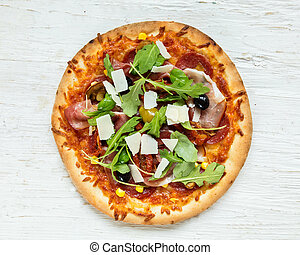 Delicious italian pizza served on wooden table, shot from...
