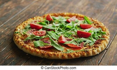Delicious italian pizza served on wooden table - Side view...