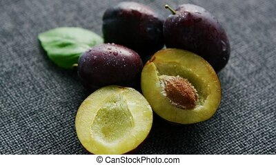 Delicious juicy plums on napkin - From above closeup shot of...