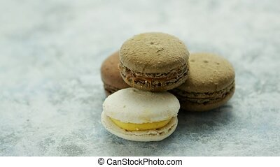 Delicious macarons pastries on marble - Closeup of white and...