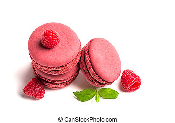 Delicious macaroons with raspberries on white background