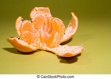 Delicious mandarine on fresh green background