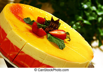 Mango Mousse Cake - Delicious Mango Mousse Cake topped with ...