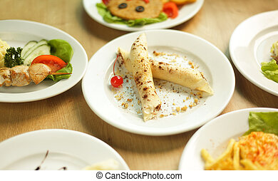 delicious meals on the table in the children's restaurant - ...