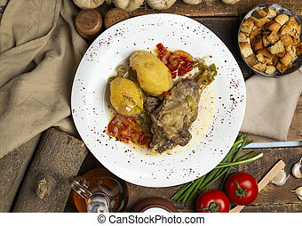 delicious meat and potato meal on dark background