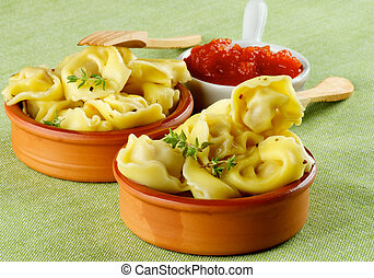 Delicious Meat Cappelletti with Herbs in Ceramic Bowls,...