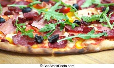 Delicious mediterranean food. Italian pizza, salami and ham.