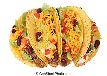 Delicious Mexican tacos isolated over white background