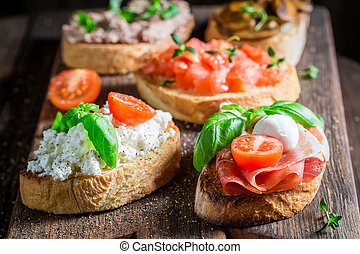 Delicious mix of bruschetta with fresh ingredients for a...