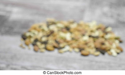 Delicious Mix of healthy raw nuts on wooden background in...