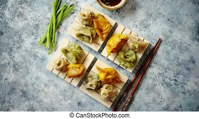 Delicious mixed kinds of chinese dumplings served on wooden...