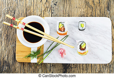 Delicious mixed sushi arranged on white marble surface