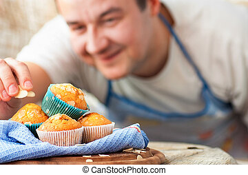 Delicious muffins - Chef is decorating delicious organic ...