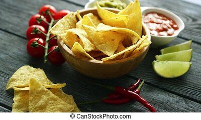 Delicious nachos and sauces on table - Arranged bowl with...