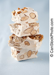 Delicious nougat - Few pieces of nougat stacked together on...
