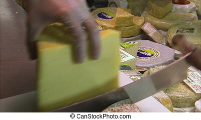 Delicious old cheese sliced thinly - A close up shot of a...