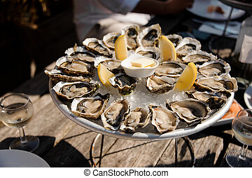 Delicious oysters on the plate on the table