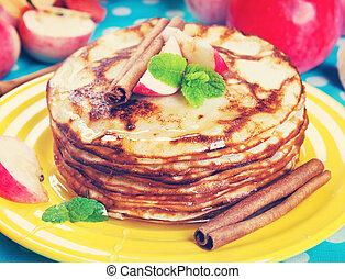 Delicious pancakes, honey apples and cinnamon. Vintage retro hip